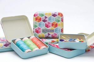 Moda Tin measures 3 1/8'' long x 3'' wide x 3/4'' deep and has a colorful hexagon print top. The tin can fit one or more of the following: one mini charm, three spools of thread (Mettler size), swatches of fabric (great to take to the store), wonder clip holder, needles, fabric eraser, small post its, small seam ripper or quilt pins! - Contents of tin not included