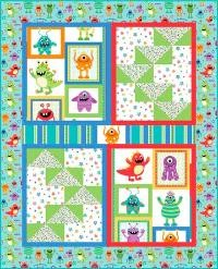 "Wednesday Quilt Pattern by Kari Nichols for Northcott Fabrics - 47 1/2"" x 57 1/2"" - Use your favorite ""themed"" fabric for two blocks and add coordinating fabrics for the remaining blocks. OR, use Christmas themed fabrics - Baby's First Christmas Quilt, Baby's First Birthday, etc."